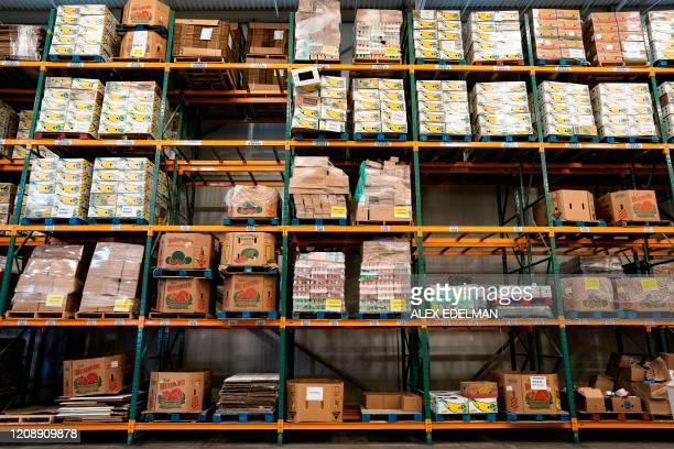 Donated supplies wait for distribution at the Capital Area Food Bank on April 1 2020 in Washington DC The coronavirus pandemic is putting a strain on...
