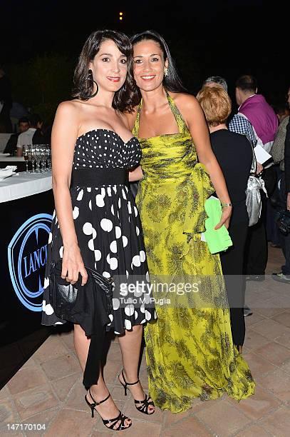 Donatella Finocchiaro and Barbara Tabita attend at the Lancia Cafe during the 58th Taormina Film Fest on June 26 2012 in Taormina Italy