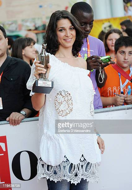 Donatella Finocchiaro poses with the 2011 Giffoni Experience Award on July 20 2011 in Giffoni Valle Piana Italy