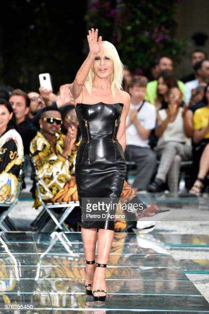 Donatella Versace acknowledges the applause of the audience at the Versace show during Milan Men's Fashion Week Spring/Summer 2019 on June 16 2018 in...