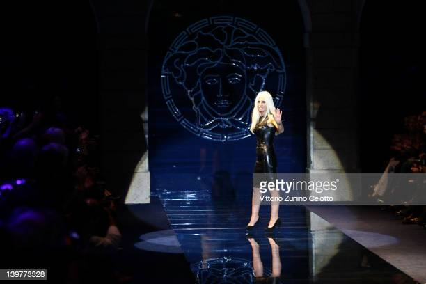 Donatella Versace acknowledges the audience after the show on the runway at Versace Autumn/Winter 2012/2013 fashion show as part of Milan Womenswear...