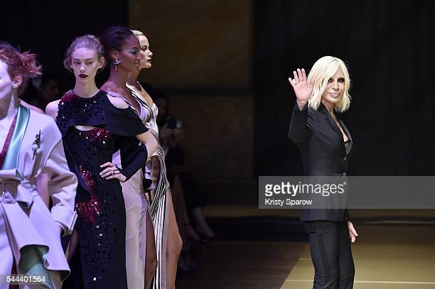 Donatella Versace acknowledges the audience during the Atelier Versace Haute Couture Fall/Winter 20162017 show as part of Paris Fashion Week on July...