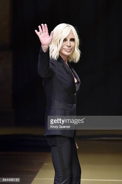 Donatella Versace acknowledges the audience during the Atelier Versace Haute Couture Fall/Winter 2016-2017 show as part of Paris Fashion Week on July...