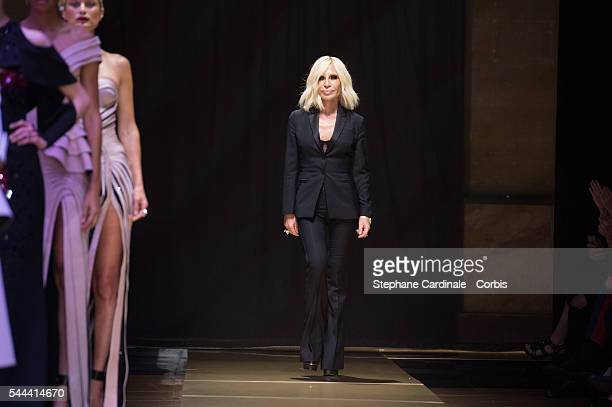 Donatella Versace acknowledges the audience during the Versace Haute Couture Fall/Winter 20162017 show as part of Paris Fashion Week on July 3 2016...