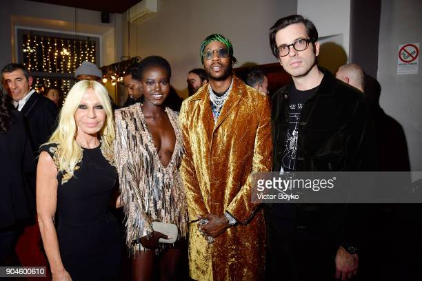 Donatella Versace Adut Akech 2Chainz and Will Welch attend the GQ Milan Cocktail Party during Milan Men's Fashion Week Fall/Winter 2018/19 on January...