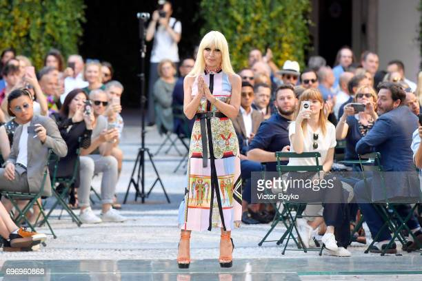 Donatella Versace aknowledges the applause of the audience at the Versace show during Milan Men's Fashion Week Spring/Summer 2018 on June 17 2017 in...