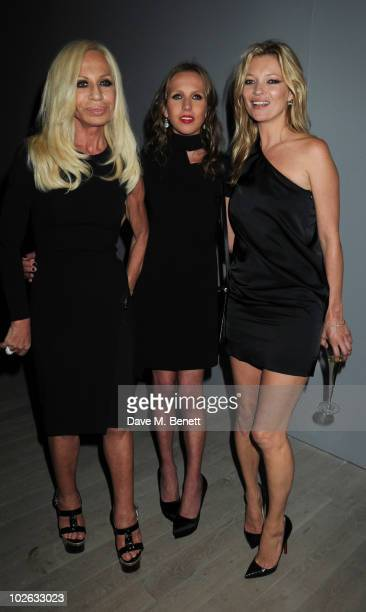 Donatella Versace Allegra Versace and Kate Moss attend the private view of 'Mario Testino Kate Who' at Phillips de Pury Company on July 5 2010 in...