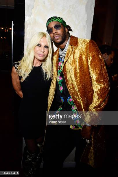 Donatella Versace and 2Chainz attend the GQ Milan Cocktail Party during Milan Men's Fashion Week Fall/Winter 2018/19 on January 13 2018 in Milan Italy
