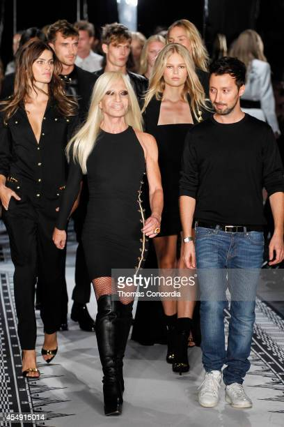 Donatella Versace and Anthony Vaccarello walk finale at Versus during MercedesBenz Fashion Week Spring 2015 at Metropolitan West on September 7 2014...