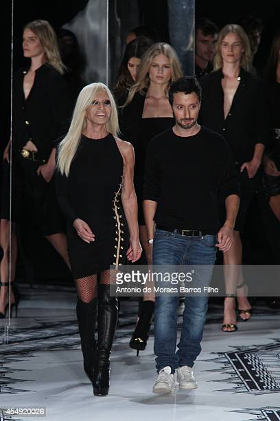 Donatella Versace and Antony Vaccarello walk the runway during the VERSUS by Antony Vaccarello show at MercedesBenz Fashion Week Spring 2015 on...