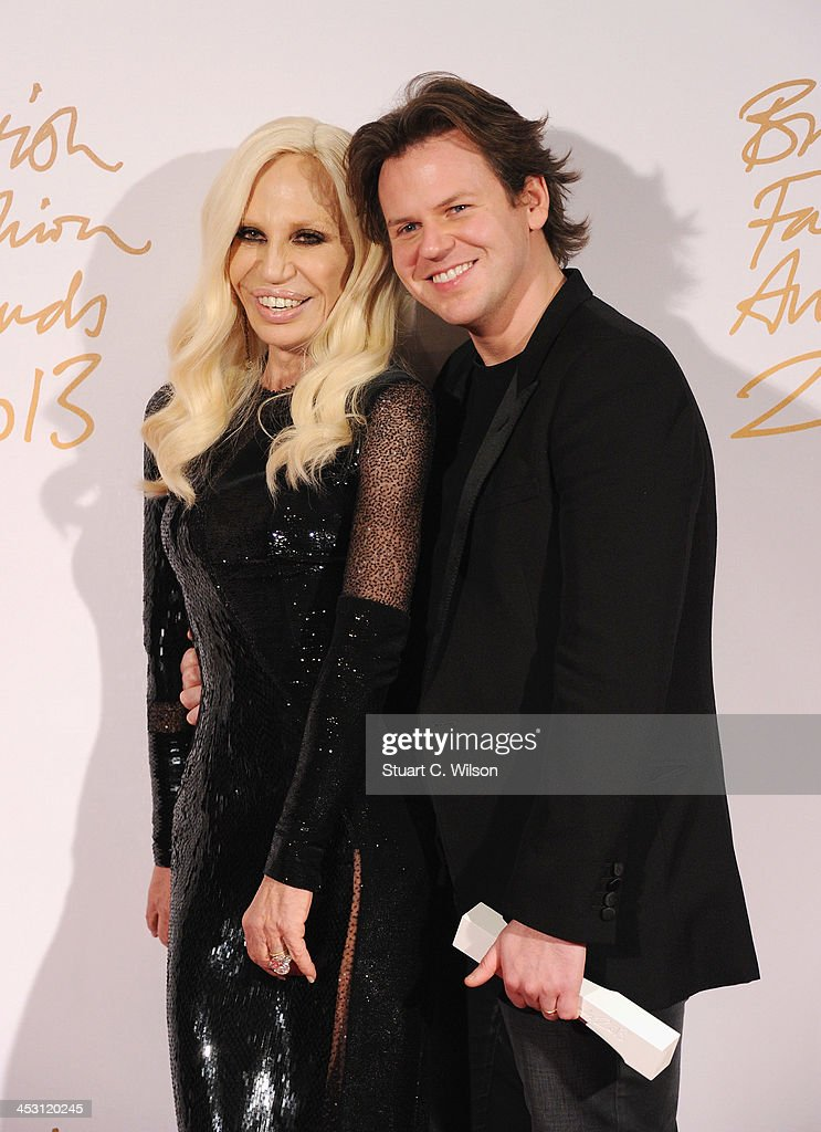 Donatella Versace and Christopher Kane pose with the Award for Womenswear Designer of the Year in the winners room at the British Fashion Awards 2013 at London Coliseum on December 2, 2013 in London, England.
