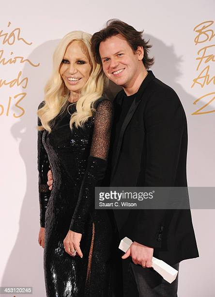 Donatella Versace and Christopher Kane pose with the Award for Womenswear Designer of the Year in the winners room at the British Fashion Awards 2013...