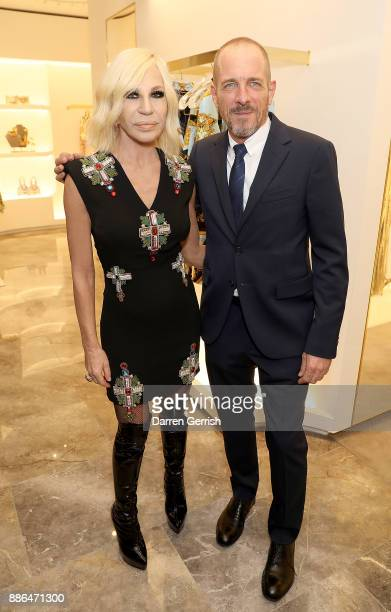 Donatella Versace and Doug Ordway attend the Versace Boutique Opening on Sloane Street on December 5 2017 in London England