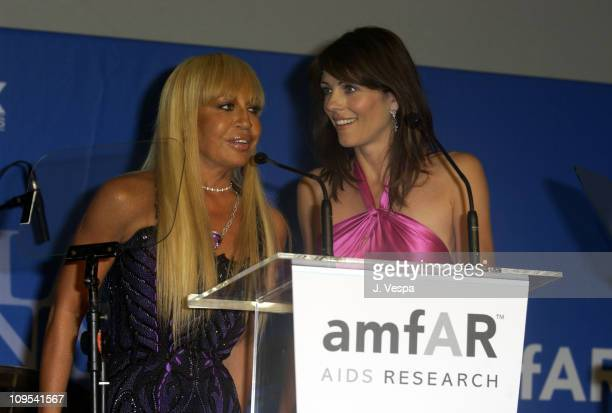 Donatella Versace and Elizabeth Hurley during 2003 Cannes Film Festival Cinema Against Aids 2003 to benefit amfAR sponsored by Miramax Auction at...