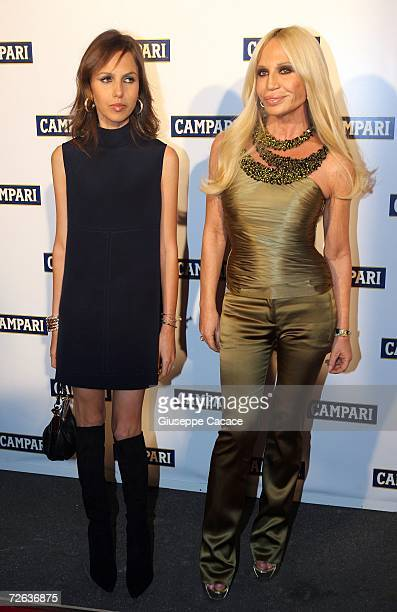 Donatella Versace and her daughter Allegra arrive at the Hotel Campari calendar release event November 23 2006 in Milan Italy