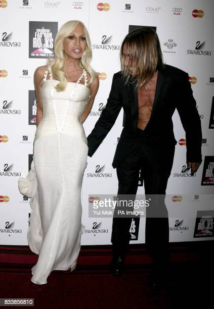 Donatella Versace and Iggy Pop arrive for Swarovski Fashion Rocks for The Prince's Trust at the Royal Albert Hall in central London