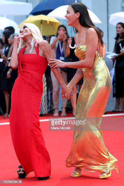 Donatella Versace and Irina Shayk walk the red carpet ahead of the 'A Star Is Born' screening during the 75th Venice Film Festival at Sala Grande on...
