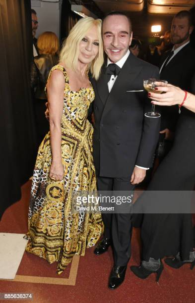 Donatella Versace and John Galliano pose backstage at The Fashion Awards 2017 in partnership with Swarovski at Royal Albert Hall on December 4 2017...