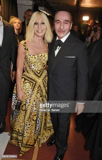 Donatella Versace and John Galliano pose backstage at The Fashion Awards 2017 in partnership with Swarovski at Royal Albert Hall on December 4 2017...