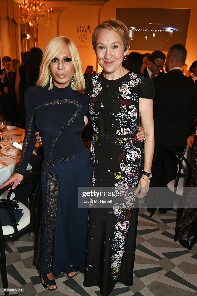 Donatella Versace (L) and Justine Picardie, editor-in-chief of Harper's Bazaar, attend the Harper's Bazaar Women of the Year Awards 2016 at Claridge's Hotel on October 31, 2016 in London, England.
