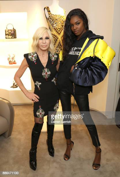 Donatella Versace and Leomie Anderson attend the Versace Boutique Opening on Sloane Street on December 5 2017 in London England