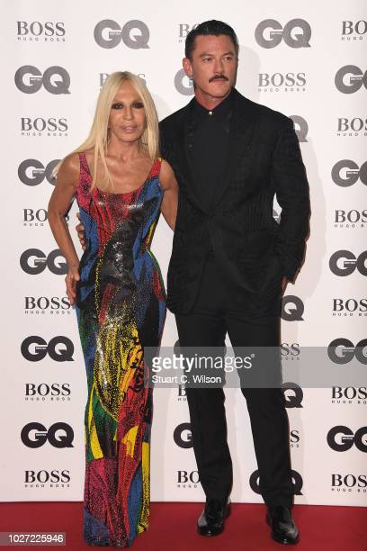 Donatella Versace and Luke Evans attends the GQ Men of the Year awards at the Tate Modern on September 5 2018 in London England