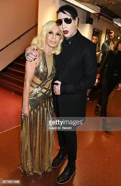 Donatella Versace and Marilyn Manson pose backstage at The Fashion Awards 2016 at Royal Albert Hall on December 5 2016 in London United Kingdom