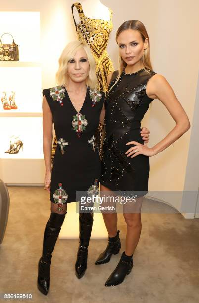 Donatella Versace and Natasha Poly attend the Versace Boutique Opening on Sloane Street on December 5 2017 in London England