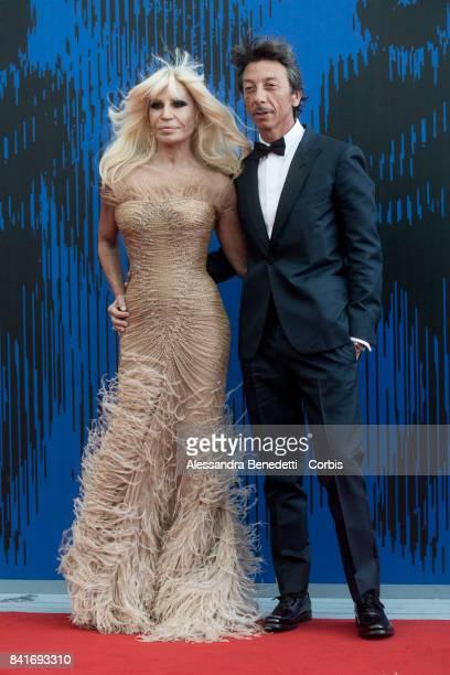 Donatella Versace and Pierpaolo Piccioli attend the The Franca Sozzani Award during the 74th Venice Film Festival at Sala Giardino on September 1...