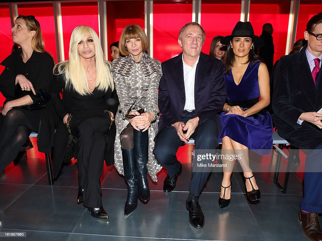 Donatella Versace, Anna Wintour, Francois-Henri Pinault and Salma Hayek attend the Christopher Kane show during London Fashion Week Fall/Winter 2013/14 at on February 18, 2013 in London, England.
