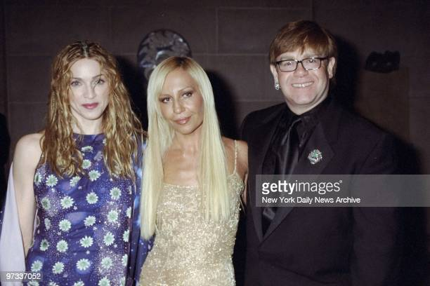 Donatella Versace is joined by Madonna and Elton John at the Metropolitan Museum of Art Costume Institute gala where the Gianni Versace Exhibition...