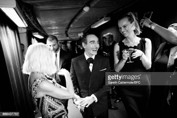 Donatella Versace, John Galliano and Eva Herzigova are seen backstage during The Fashion Awards 2017 in partnership with Swarovski at Royal Albert...