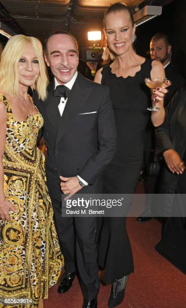 Donatella Versace John Galliano and Eva Herzigova pose backstage at The Fashion Awards 2017 in partnership with Swarovski at Royal Albert Hall on...