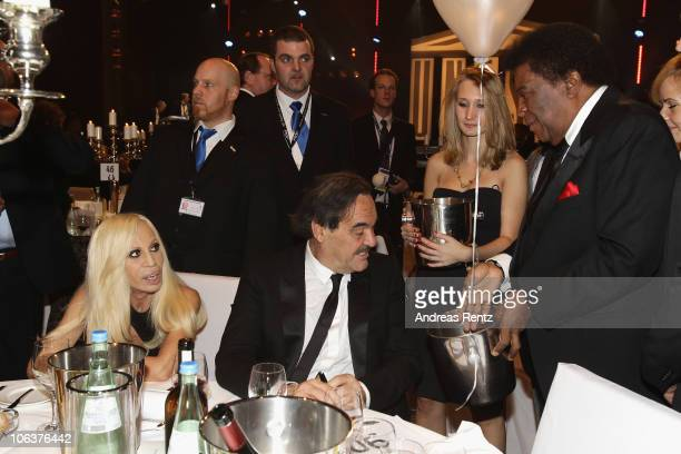 Donatella Versace Oliver Stone and Roberto Blanco attend the UNESCO CharityGala 2010 at Maritim Hotel on October 30 2010 in Duesseldorf Germany