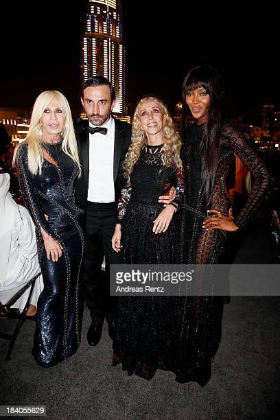 Donatella Versace Riccardo Tisci Franca Sozzani and Naomi Campbell attend the gala dinner at the Armani Pavilion during Vogue Fashion Dubai...