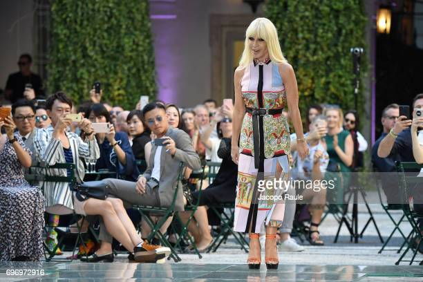 Donatella Versace walks the runway at the Versace show during Milan Men's Fashion Week Spring/Summer 2018 on June 17 2017 in Milan Italy