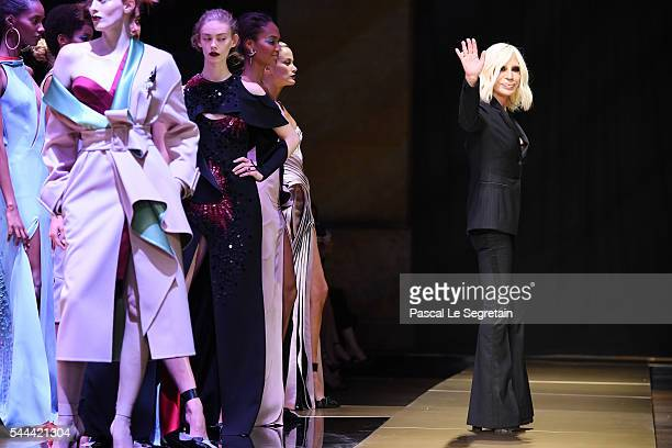 Donatella Versace walks the runway during the Atelier Versace Haute Couture Fall/Winter 20162017 show as part of Paris Fashion Week on July 3 2016 in...