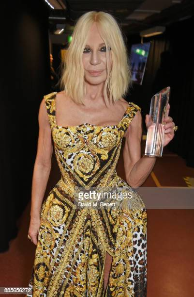 Donatella Versace winner of the Fashion Icon award poses backstage at The Fashion Awards 2017 in partnership with Swarovski at Royal Albert Hall on...