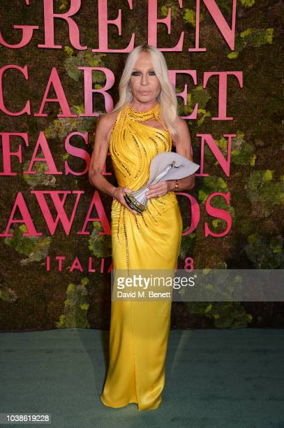 Donatella Versace winner of the The CNMI in Recognition for Sustainability poses backstage at The Green Carpet Fashion Awards Italia 2018 at Teatro...