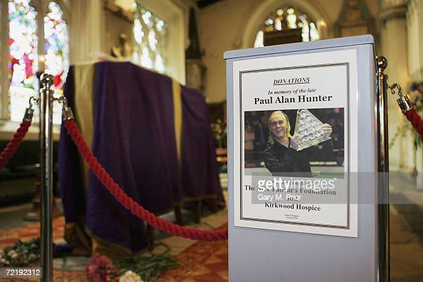 A donation box for charity stands beside snooker player Paul Hunter's coffin at Leeds Parish Church on October 17 2006 in Leeds England The threetime...