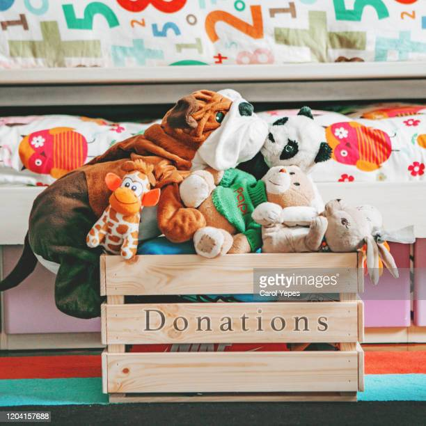 donation box with kid toys - giving stock pictures, royalty-free photos & images