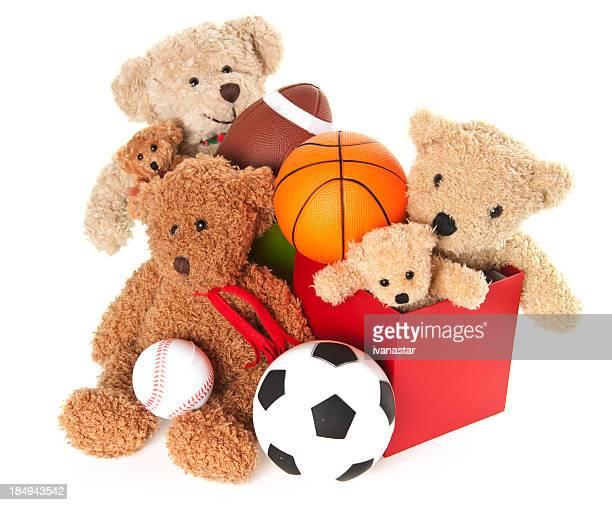 Spendenbüchse mit Teddybär, Bälle und Spielzeug