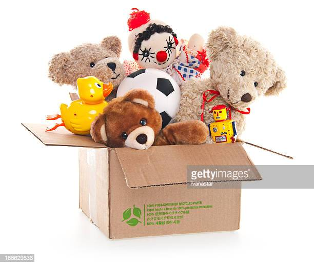 donation box with teddy bear, robots and toys - toy stock pictures, royalty-free photos & images
