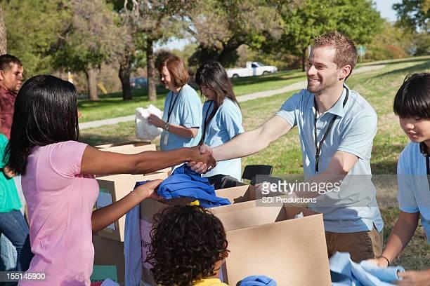 Donation center volunteer thanking donator