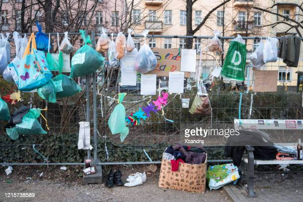 donation fence, where people can leave food and clothes donations while keeping social distance during covid-19 crisis - altruismo foto e immagini stock