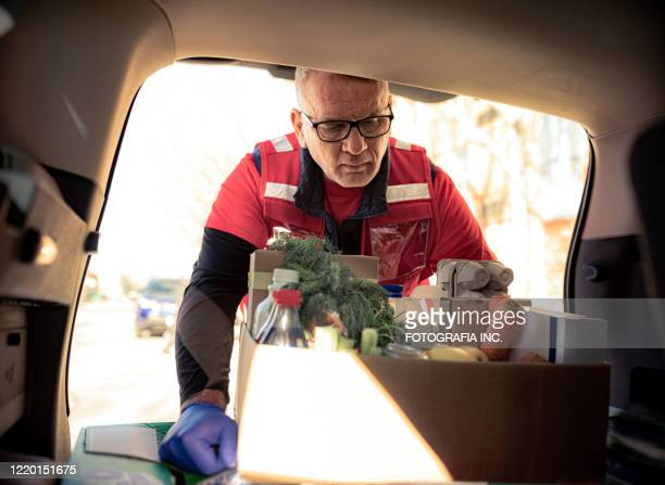 covid-19, donation home food delivery during lockdown - charitable donation stock pictures, royalty-free photos & images