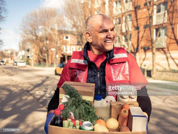 covid-19, donation home food delivery during lockdown - charity and relief work stock pictures, royalty-free photos & images