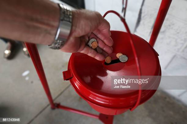 A donation is made into a Salvation Army red kettle on Giving Tuesday on November 28 2017 in Hallandale Florida Giving Tuesday is a single day...