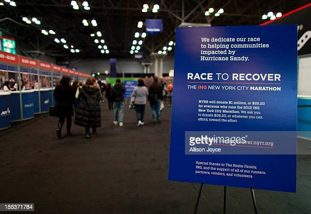 A donation sign is seen during New York City Marathon runner check in at the Javits Center November 3 2012 in New York City Mayor Michael Bloomberg...