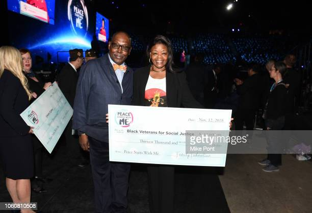 A donation to Black Veterans for Social Justice is presented during Peace Starts With Me concert at Nassau Coliseum on November 12 2018 in Uniondale...